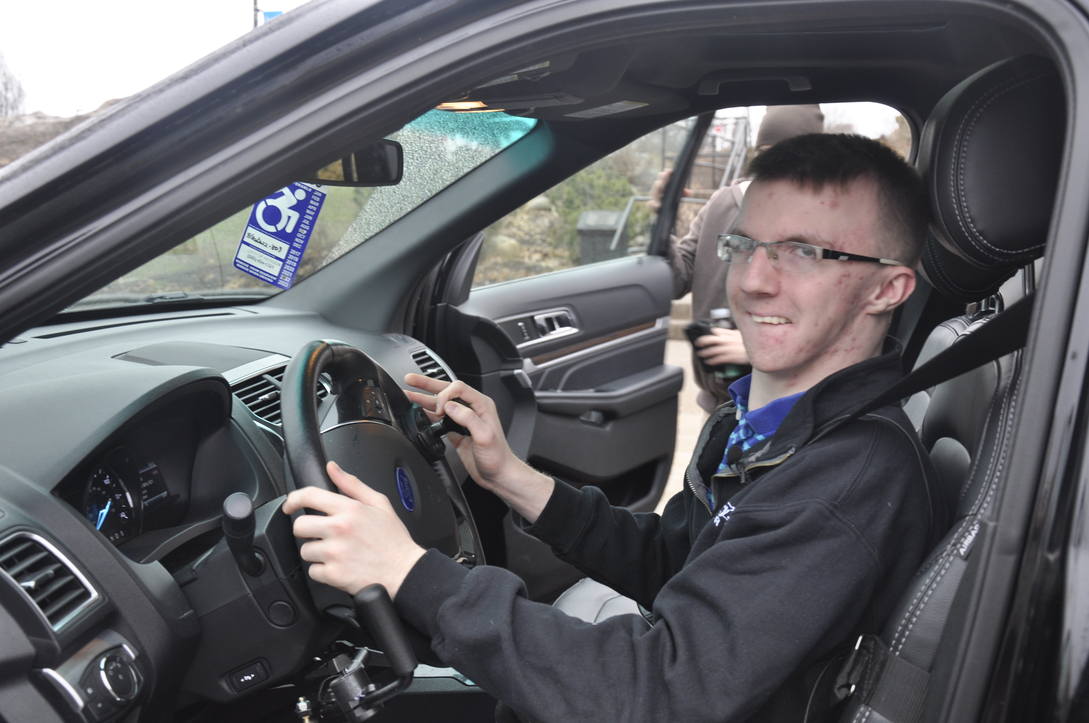 Russell Cunningham behind the wheel of his SUV.